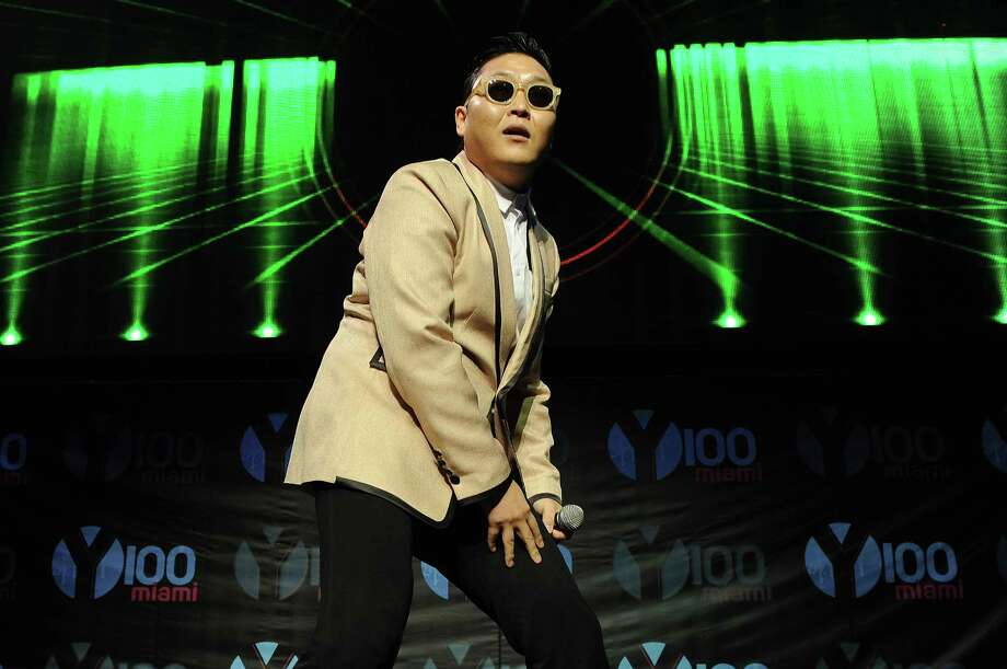 "FILE - This Dec. 8, 2012 file photo shows South Korean pop star PSY during the Y100's Jingle Ball 2012 at the BB&T Center in Ft Lauderdale, Fla. PSY's first new single since his viral hit ""Gangnam Style"" is stealing attention from inter-Korean tensions. YG Entertainment, PSY's agency, says ""Gentleman"" was released in 119 countries on Friday, April 12, 2013.  PSY co-composed the electronic dance music and wrote the lyrics for the song, which pokes fun at a self-claimed gentleman who enjoys his time at a dance club.  (Photo by Jeff Daly/Invision/AP, file) Photo: Jeff Daly"