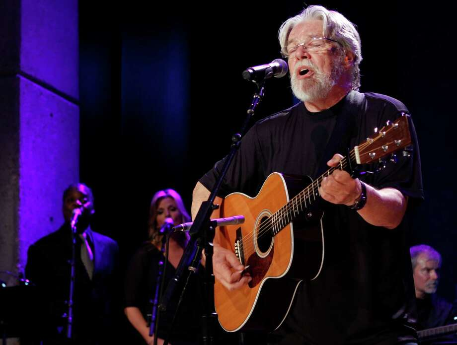 "FILE - This Oct. 21, 2012 file photo shows Bob Seger performing at the Country Music Hall of Fame Inductions in Nashville, Tenn. Former coma patient Evie Branan attended Seger's concert Thursday, April 11, 2013, at The Palace of Auburn Hills in Michigan. Branan, of Flint Township, emerged from a five-year semi-coma  on May 7, 2011.  Her first words were, ""I want to go to a Bob Seger concert.""  She also met Seger and his family, talked with crew and band members and received VIP treatment. (Photo by Wade Payne/Invision/AP, file) Photo: Wade Payne"