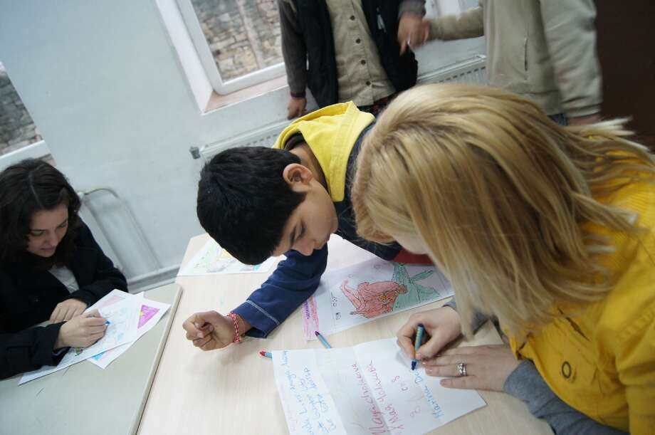 Marina, the best team leader in the whole entire world, is coloring with one of the funniest kids at the orphanage!  Photo by Rosa D\'Ambrosio.