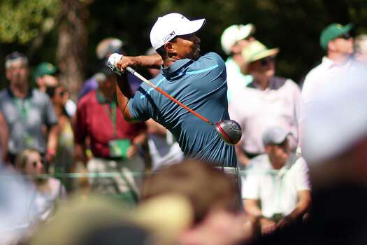 AUGUSTA, GA - APRIL 13:  Tiger Woods of the United States hits a tee shot on the ninth hole during the third round of the 2013 Masters Tournament at Augusta National Golf Club on April 13, 2013 in Augusta, Georgia. Photo: Mike Ehrmann, Getty Images / 2013 Getty Images