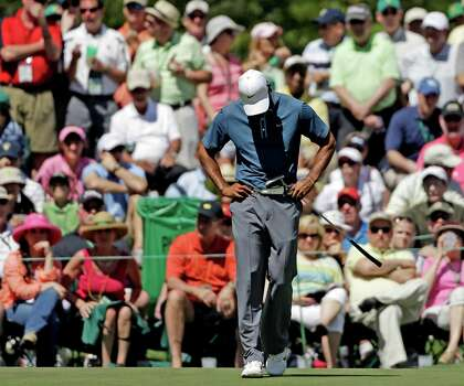 Tiger Woods puts his down after missing a putt on the sixth hole during the third round of the Masters golf tournament Saturday, April 13, 2013, in Augusta, Ga. (AP Photo/David Goldman) Photo: David Goldman, Associated Press / AP