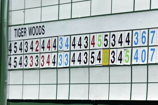 AUGUSTA, GA - APRIL 13:  The leaderboard showing a scoring adjustment on the 15th hole for Tiger Woods of the United States is seen during the third round of the 2013 Masters Tournament at Augusta National Golf Club on April 13, 2013 in Augusta, Georgia. Photo: Andrew Redington, Getty Images / 2013 Getty Images