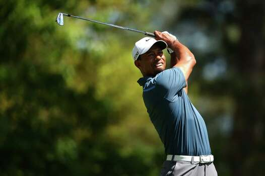 AUGUSTA, GA - APRIL 13:  Tiger Woods of the United States watches his tee shot on the fourth hole during the third round of the 2013 Masters Tournament at Augusta National Golf Club on April 13, 2013 in Augusta, Georgia. Photo: Mike Ehrmann, Getty Images / 2013 Getty Images