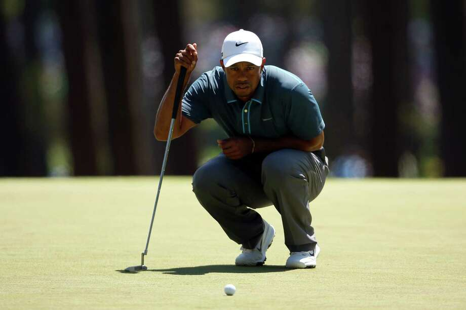 AUGUSTA, GA - APRIL 13:  Tiger Woods of the United States lines up a putt on the third hole during the third round of the 2013 Masters Tournament at Augusta National Golf Club on April 13, 2013 in Augusta, Georgia. Photo: Mike Ehrmann, Getty Images / 2013 Getty Images