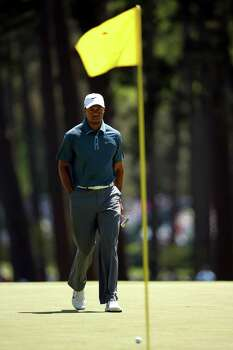 AUGUSTA, GA - APRIL 13:  Tiger Woods of the United States reacts to his putt on the third hole during the third round of the 2013 Masters Tournament at Augusta National Golf Club on April 13, 2013 in Augusta, Georgia. Photo: Mike Ehrmann, Getty Images / 2013 Getty Images
