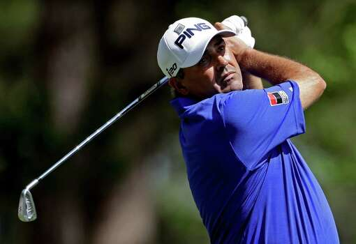 Angel Cabrera, of Argentina, watches his tee shot on the fourth hole during the third round of the Masters golf tournament Saturday, April 13, 2013, in Augusta, Ga. (AP Photo/Darron Cummings) Photo: Darron Cummings, Associated Press / AP