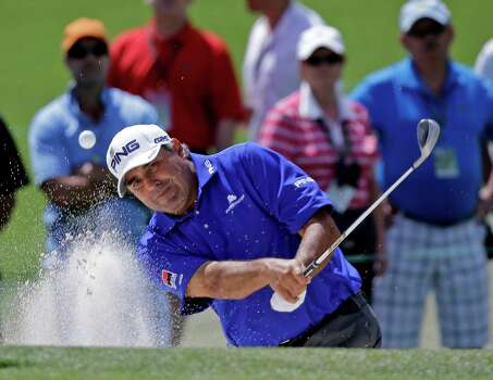 Angel Cabrera, of Argentina, hits out of a bunker on the second green during the third round of the Masters golf tournament Saturday, April 13, 2013, in Augusta, Ga. (AP Photo/David J. Phillip) Photo: David J. Phillip, Associated Press / AP