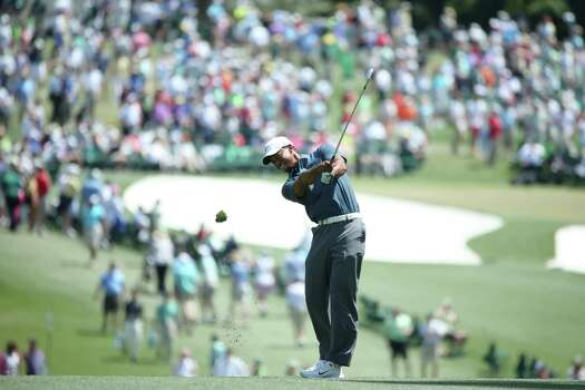 AUGUSTA, GA - APRIL 13:  Tiger Woods of the United States hits his second shot on the first hole during the third round of the 2013 Masters Tournament at Augusta National Golf Club on April 13, 2013 in Augusta, Georgia. Photo: Andrew Redington, Getty Images / 2013 Getty Images