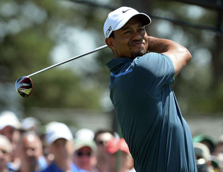 Tiger Woods of the US plays during the third round of the 77th Masters golf tournament at Augusta National Golf Club on April 13, 2013 in Augusta, Georgia.  AFP PHOTO /  JEWEL SAMADJEWEL SAMAD/AFP/Getty Images Photo: JEWEL SAMAD, AFP/Getty Images / AFP
