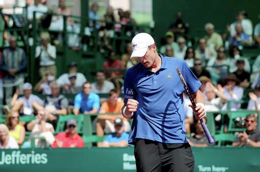 4/12/13: John Isner (USA) pumps his fist after scoring against Juan Monaco (ARG)  in the semi finals of the River Oaks US Men's Clay Court Championship at River Oaks Country Club in Houston, Texas. Almagro won 6-2, 6-1. Photo: Thomas B. Shea, For The Chronicle / © 2013 Thomas B. Shea