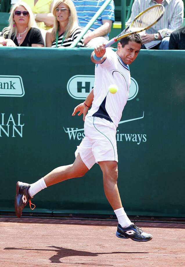 4/12/13: Nicolas Almagro (ESP) returns a backhand against Ryhne Williams (USA) in the semi finals of the River Oaks US Men's Clay Court Championship at River Oaks Country Club in Houston, Texas. Almagro won 6-2, 6-1. Photo: Thomas B. Shea, For The Chronicle / © 2013 Thomas B. Shea