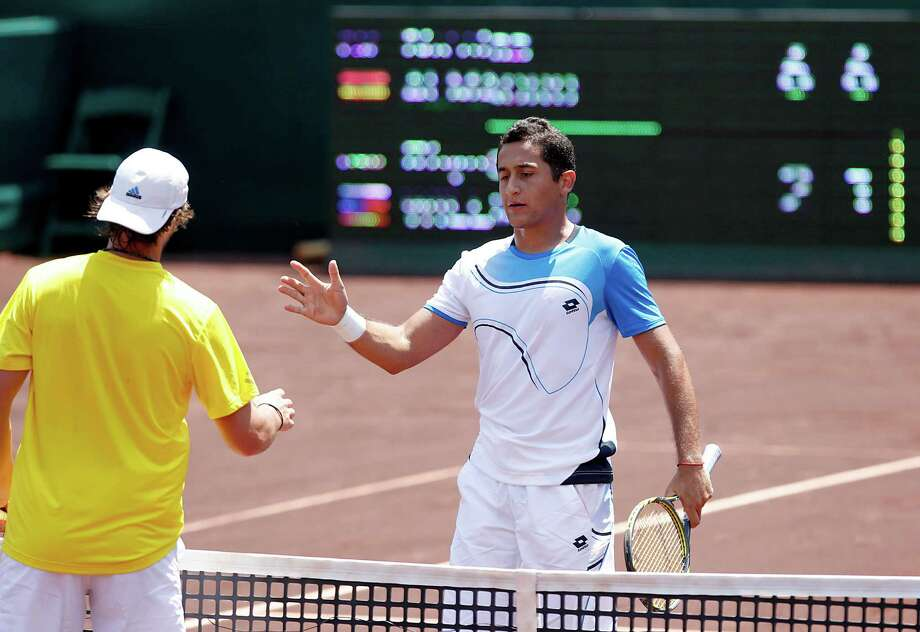4/12/13: Nicolas Almagro (ESP) shakes hands after defeating Ryhne Williams (USA) in the semi finals of the River Oaks US Men's Clay Court Championship at River Oaks Country Club in Houston, Texas. Almagro won 6-2, 6-1. Photo: Thomas B. Shea, For The Chronicle / © 2013 Thomas B. Shea