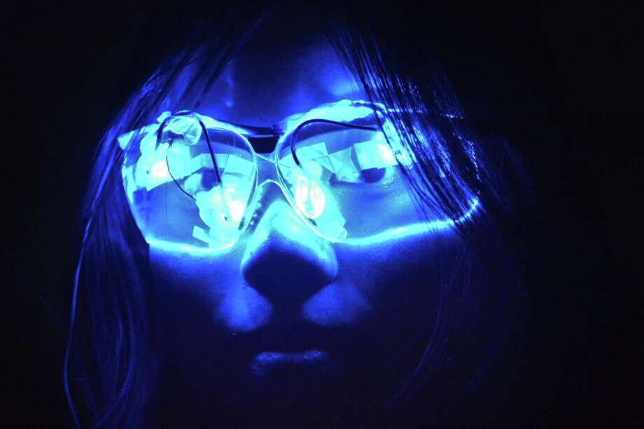 RPI student Anna Lok with colored LED glasses being studied in the light and health program at the school's Lighting Research Center in Troy Tuesday March 26, 2013.  (John Carl D'Annibale / Times Union) Photo: John Carl D'Annibale / 00021722A