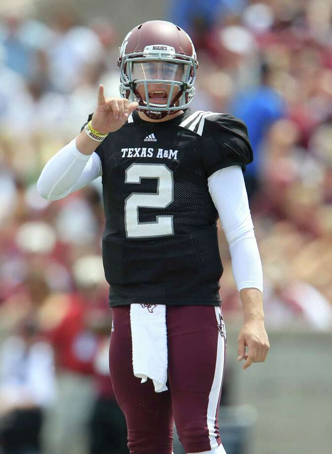 Texas A&M Aggies quarterback Johnny Manziel (2) between plays during the first half of the Texas A&M University's Maroon & White, spring game at Kyle Field, Saturday, April 13, 2013, in College Station. Photo: Karen Warren, Houston Chronicle / © 2013 Houston Chronicle