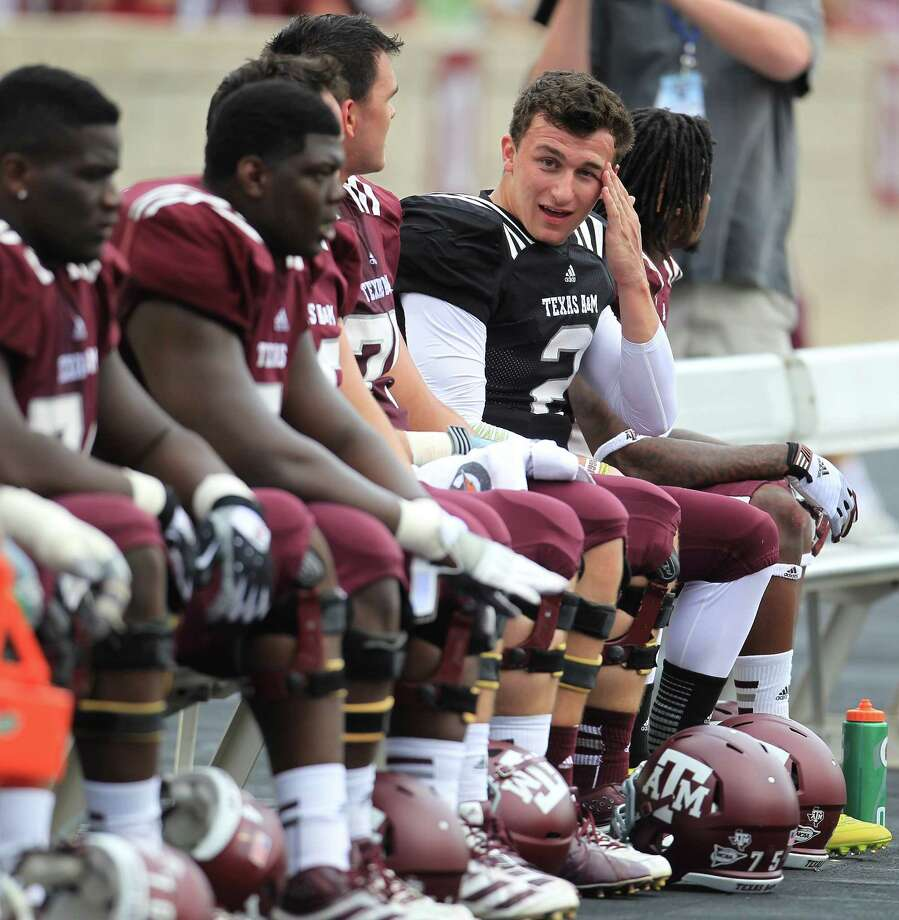 Texas A&M Aggies quarterback Johnny Manziel (2) sits on the bench after he tried to block for Texas A&M Aggies running back Brandon Williams (28) during the first half of the Texas A&M University's Maroon & White, spring game at Kyle Field, Saturday, April 13, 2013, in College Station. Photo: Karen Warren, Houston Chronicle / © 2013 Houston Chronicle