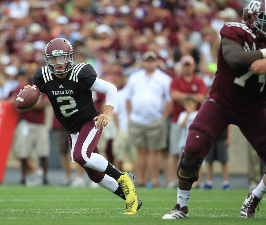 Texas A&M Aggies quarterback Johnny Manziel (2) scrambles during the first half of the Texas A&M University's Maroon & White, spring game at Kyle Field, Saturday, April 13, 2013, in College Station. Photo: Karen Warren, Houston Chronicle / © 2013 Houston Chronicle