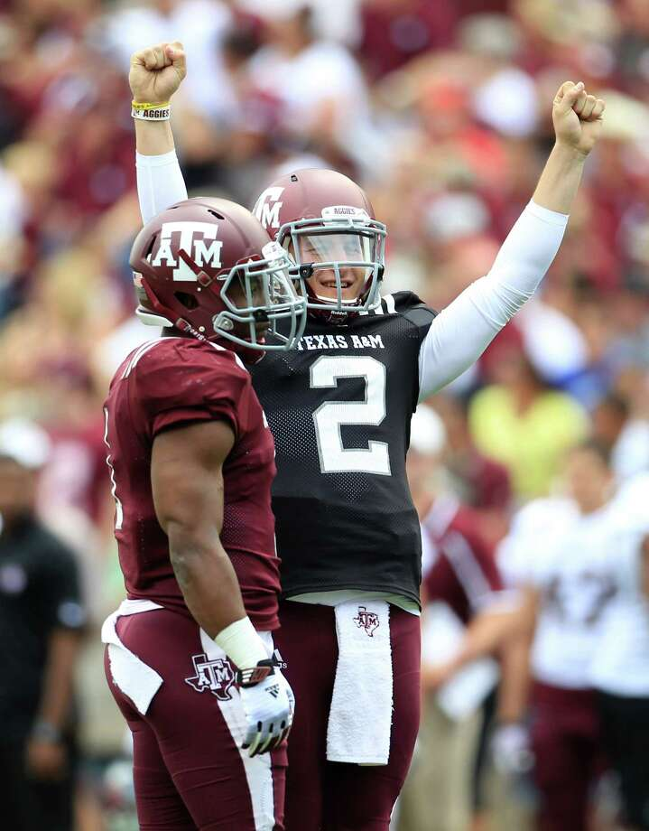 Texas A&M Aggies quarterback Johnny Manziel (2) reacts  during the first half of the Texas A&M University's Maroon & White, spring game at Kyle Field, Saturday, April 13, 2013, in College Station. Photo: Karen Warren, Houston Chronicle / © 2013 Houston Chronicle