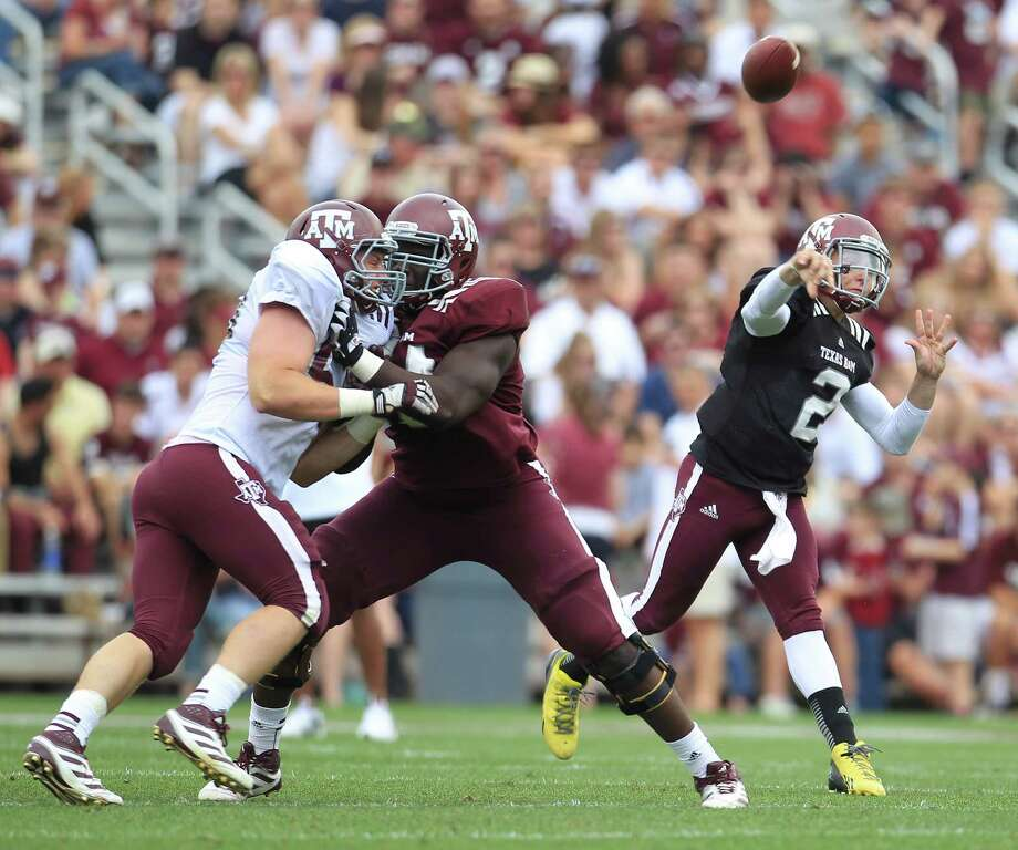Texas A&M Aggies quarterback Johnny Manziel (2) throws the ball during the first half of the Texas A&M University's Maroon & White, spring game at Kyle Field, Saturday, April 13, 2013, in College Station. Photo: Karen Warren, Houston Chronicle / © 2013 Houston Chronicle