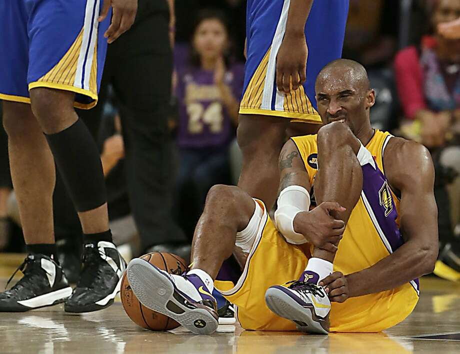 The Los Angeles Lakers' Kobe Bryant writhes in pain on the court late in the game against the Golden State Warriors at Staples Center in Los Angeles, California, on Friday, April 12, 2013. Bryant is expected to be out 6-9 months after Achilles surgery. (Robert Gauthier/Los Angeles Times/MCT) Photo: Robert Gauthier, McClatchy-Tribune News Service
