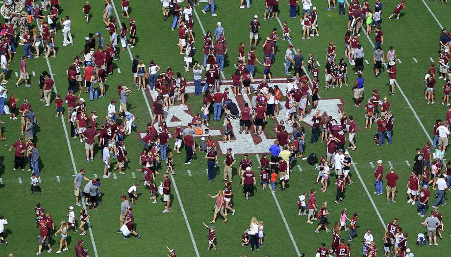 Texas A&M fans swarm onto the field after the Texas A&M University's Maroon & White, spring game at Kyle Field, Saturday, April 13, 2013, in College Station. Photo: Karen Warren, Houston Chronicle / © 2013 Houston Chronicle