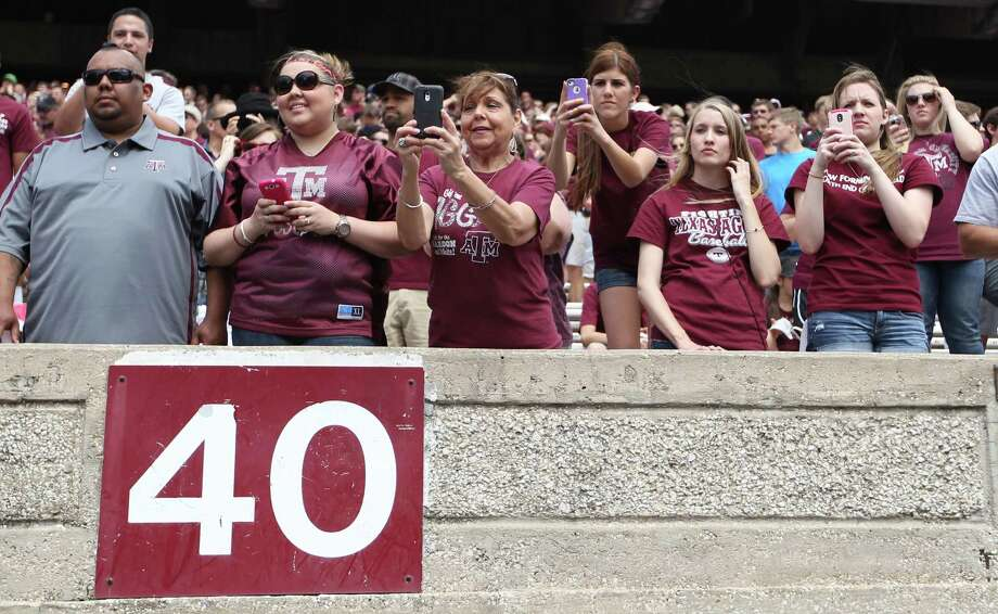 Fans take photos of Texas A&M Aggies quarterback Johnny Manziel (2) sitting on the bench during the first half of the Texas A&M University's Maroon & White, spring game at Kyle Field, Saturday, April 13, 2013, in College Station. Photo: Karen Warren, Houston Chronicle / © 2013 Houston Chronicle