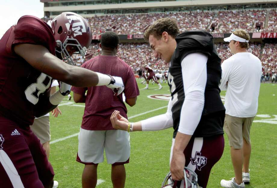 Texas A&M Aggies quarterback Johnny Manziel (2) horses around with tight end Nehemiah Hicks (81) on the sideline  during the first half of the Texas A&M University's Maroon & White, spring game at Kyle Field, Saturday, April 13, 2013, in College Station. Photo: Karen Warren, Houston Chronicle / © 2013 Houston Chronicle