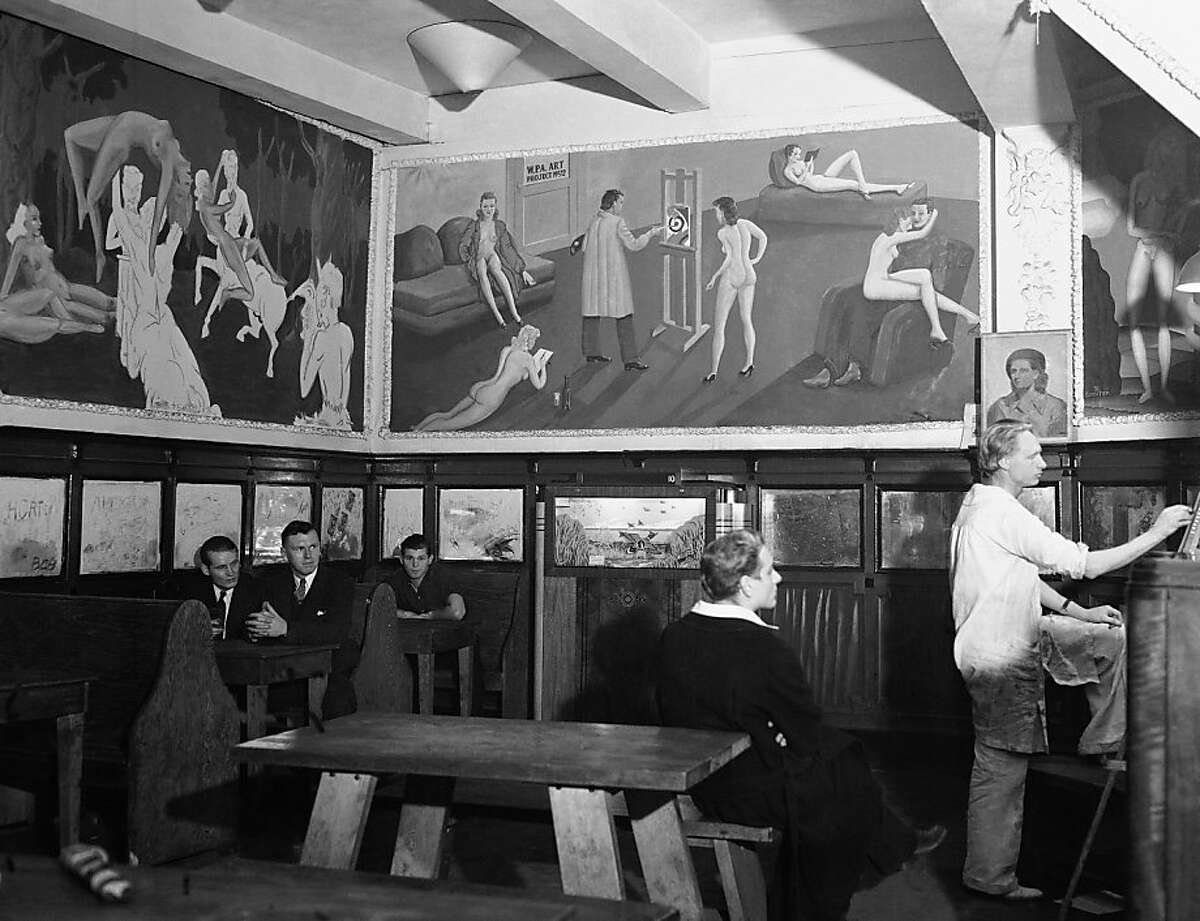 """One of the arty cafes that now are encroaching on the old Barbary Coast district of San Francisco. This scene is in Mona's, favorite lounging place for the Telegraph Hill artistic colony shown in this photo dated September 17, 1934. The large mural in the center of the picture is a satire on the WPA Artists project. The portrait artist at the lower right identifies himself only as """"Rich."""" (AP Photo)"""