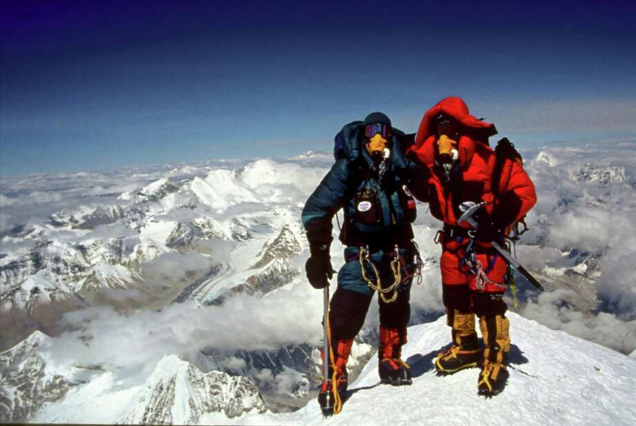 Brad and Sherman Bull on the peak of Mt. Everest in 2001. Sherman was, at 64, the oldest man in the world to summit Everest. Photo: Contributed