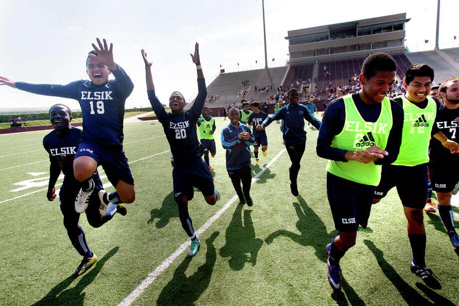 The Elsik Rams celebrate after winning their Region III Final matchup against the Deer Park Deers 1-0 at Clyde Abshier Stadium, Saturday, April 13, 2013, in Deer Park. Photo: Cody Duty, Houston Chronicle / © 2013 Houston Chronicle
