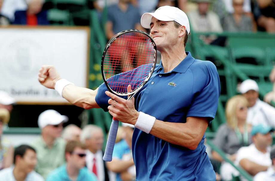 4/12/13: John Isner (USA) pumps his fist after he defeated Juan Monaco (ARG)  in the semi finals of the River Oaks US Men's Clay Court Championship at River Oaks Country Club in Houston, Texas. Isner won 1-6,6-4,6-4. Photo: Thomas B. Shea, For The Chronicle / © 2013 Thomas B. Shea