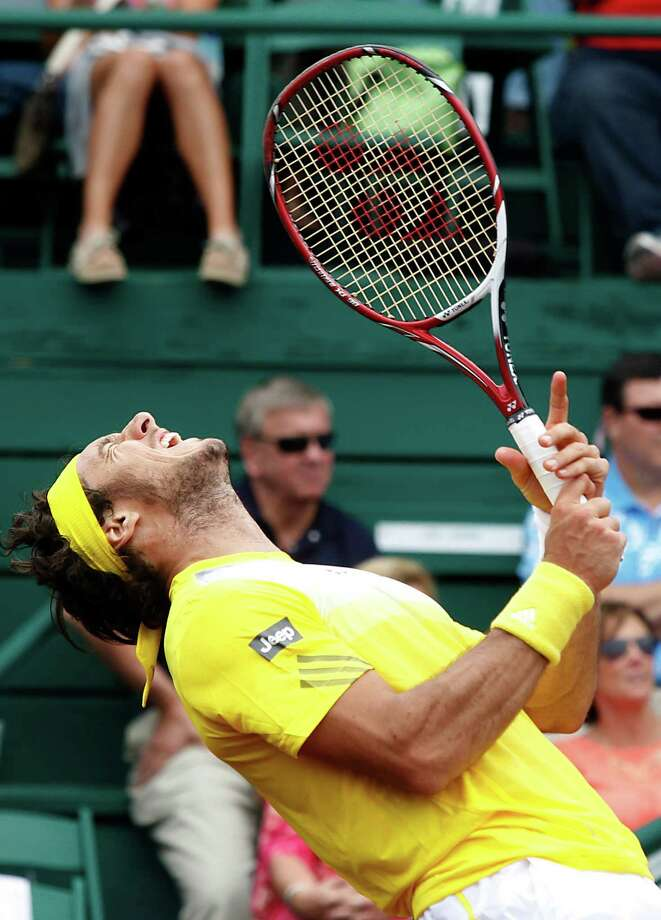 4/12/13: Juan Monaco (ARG) screams as his return shot hits the net against  John Isner (USA)  in the semi finals of the River Oaks US Men's Clay Court Championship at River Oaks Country Club in Houston, Texas. Isner won 1-6,6-4,6-4. Photo: Thomas B. Shea, For The Chronicle / © 2013 Thomas B. Shea