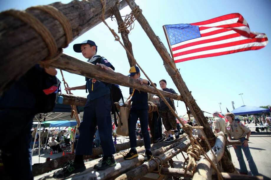 "Owen Chia, of Cub Scout Troop #711, walks on a Log Bridge made by Tomball Boy Scout Troop #41 as they display their Pioneering Skills during the Scout Fair 2013, ""The Best Scout Fair on Earth"", at Reliant Arena on Saturday, April 13, 2013, in Houston. Photo: Mayra Beltran, Houston Chronicle / © 2013 Houston Chronicle"