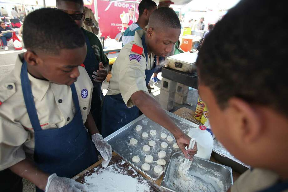 "(Left to right) Kaleb Small, 11, and Deshaun Miller, 14, of  Boy Scout Troop #352, whip up a batch of biscuits to be cooked in a dutch oven during the Scout Fair 2013, ""The Best Scout Fair on Earth"", at Reliant Arena on Saturday, April 13, 2013, in Houston. Photo: Mayra Beltran, Houston Chronicle / © 2013 Houston Chronicle"