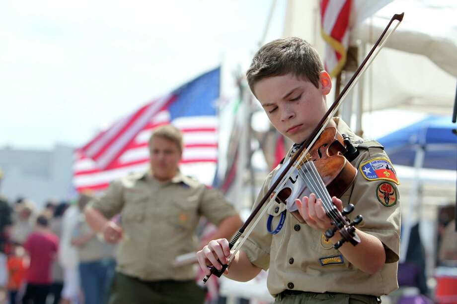 "Daniel Vannoy, 13, plays the fiddle in front of Boy Scout Troop #40 booth during the Scout Fair 2013, ""The Best Scout Fair on Earth"", at Reliant Arena on Saturday, April 13, 2013, in Houston. Photo: Mayra Beltran, Houston Chronicle / © 2013 Houston Chronicle"