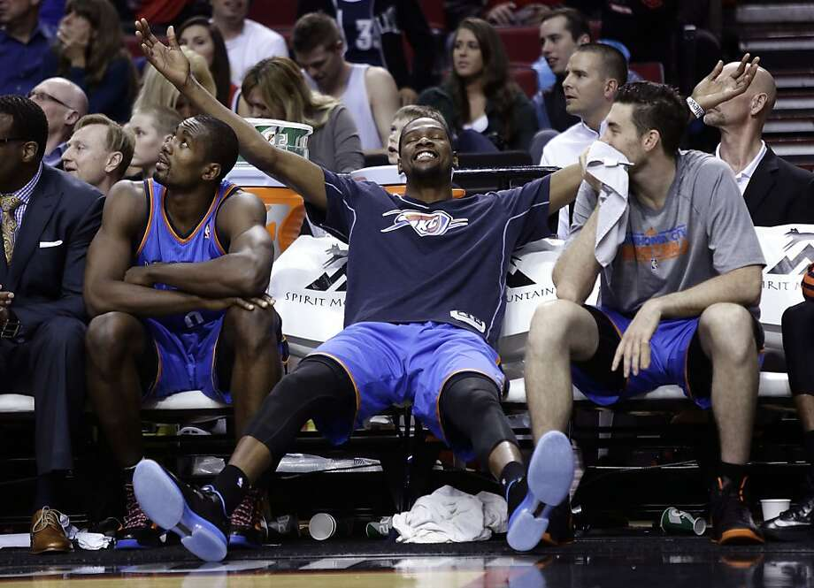 Oklahoma City's Kevin Durant stretches out to savor his team's victory over Portland with Serge Ibaka (left) and Nick Collison. The Warriors hope to emulate the Thunder's growth. Photo: Don Ryan, Associated Press