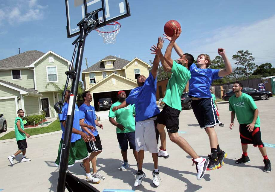 Eric Lopez, 23, controls the ball and scores during the Cricket & Rockets Driveway Challenge on Saturday, April 13, 2013, in Houston.  Eric Lopez is the winner of the Cricket & Rockets Driveway Challenge where Houston Rockets Greg Smith and Donatas Motiejunas coach two teams made up of Eric Lopez family and friends. Photo: Mayra Beltran, Houston Chronicle / © 2013 Houston Chronicle
