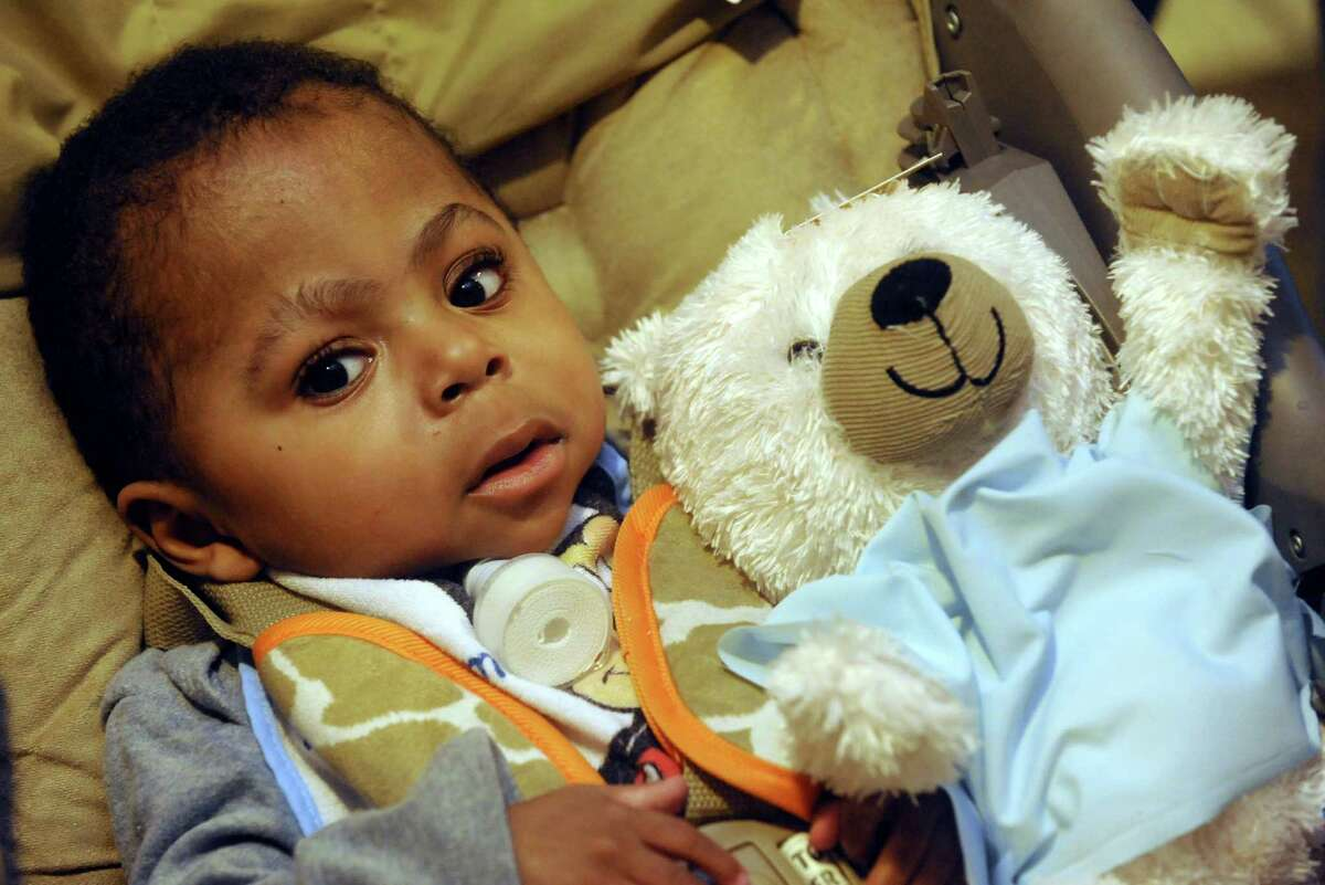 Jashai Dukes, 1, of Albany waits with his bear patiently for his checkup as Albany Medical College students hosted their 18th Annual Teddy Bear Hospital Day on Saturday April 13, 2013 in Albany, N.Y. (Michael P. Farrell/Times Union)