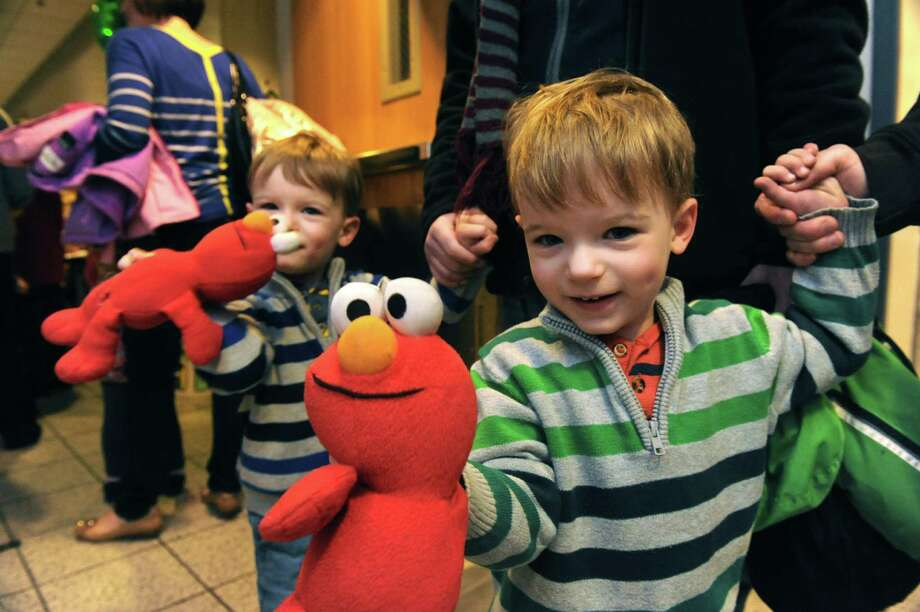 Two-year-old twin brothers Joseph, left, and Theodore Burke of Albany bring their Elmos in for a checkup as Albany Medical College students hosted their 18th Annual Teddy Bear Hospital Day on Saturday April 13, 2013 in Albany, N.Y. (Michael P. Farrell/Times Union) Photo: Michael P. Farrell