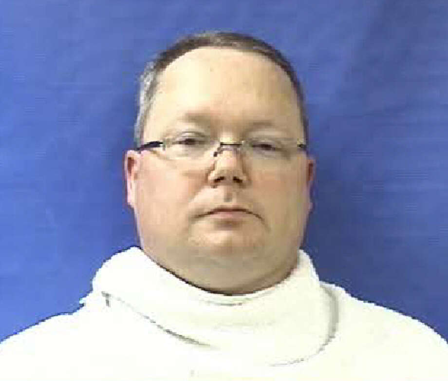 """This photo provided by the Kaufman County Sheriff's Office shows Eric Williams. Williams was admitted to the Kaufman County Jail, in Kaufman, Texas, early Saturday, April 13, 2013, and charged with making a """"terroristic threat."""" Federal and local authorities searched Williams' home Friday as part of an investigation into the deaths of District Attorney Mike McLelland and his wife, Cynthia. (AP Photo/Kaufman County Sheriff's Office) Photo: Uncredited, HOPD / Kaufman County Sheriff's Office"""