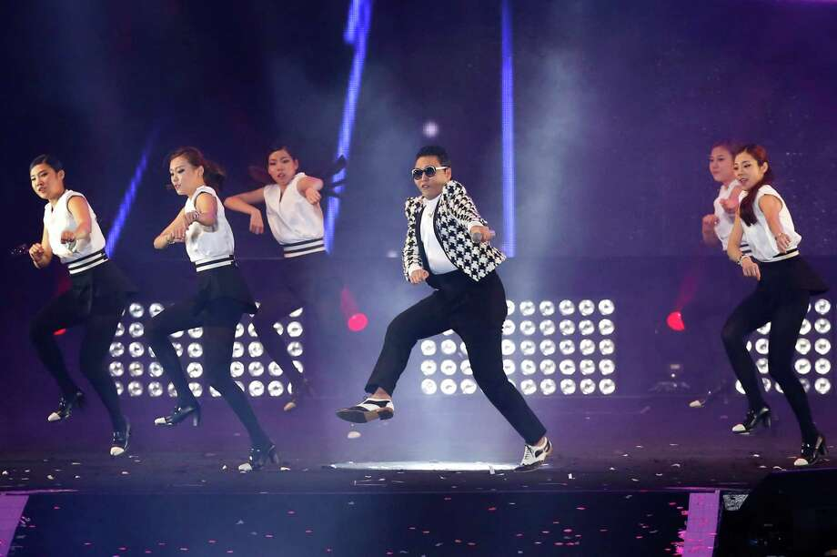 "South Korean rapper PSY, in a checkered jacket, performs his new song ""Gentleman"" in his concert titled ""Happening"" in Seoul, South Korea Saturday, April 13, 2013. PSY's first new single since his megahit ""Gangnam Style"" was released in 119 countries on Friday, his agency said. Photo: Kin Cheung, Associated Press / AP"
