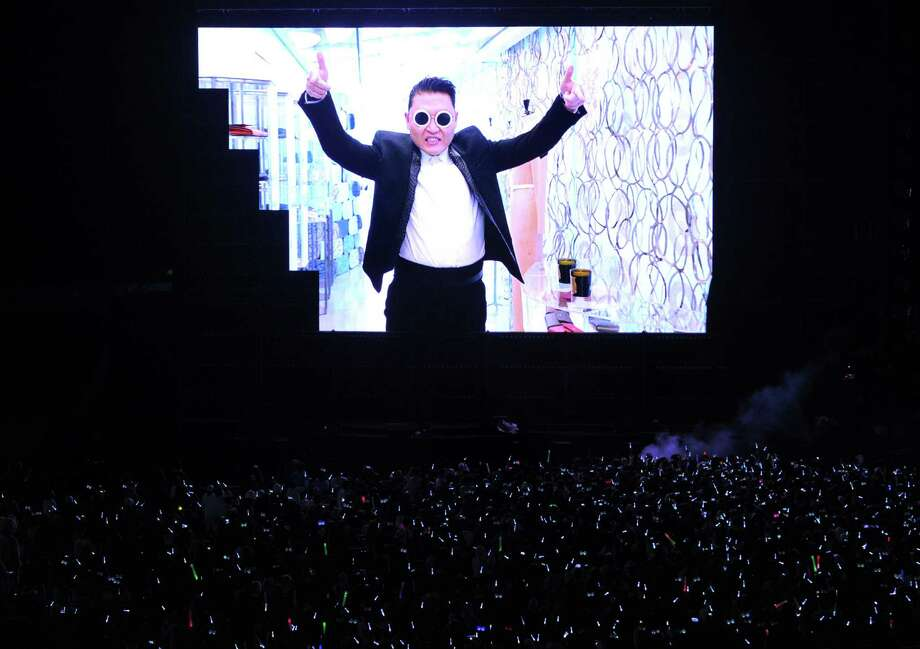 "A video of ""Gangnam Style"" star Psy's new single ""Gentleman"" is beamed during the concert ""Happening"" in Seoul on April 13, 2013.  South Korean pop star Psy unveiled 13 April the hip-swinging dance and music video for his new song, aimed at replicating the global success of ""Gangnam Style"" and its famed horse-riding dance. Photo: KIM JAE-HWAN, AFP/Getty Images / KIM JAE-HWAN"
