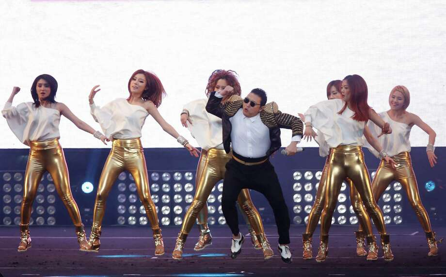 "South Korean rapper PSY performs at his concert ""Happening"" in Seoul, South Korea Saturday, April 13, 2013. Photo: Kin Cheung, Associated Press / AP"
