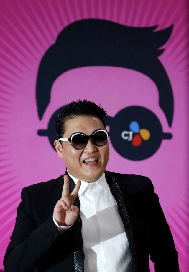 "South Korean rapper PSY poses for photographers during a news conference for his concert ""Happening"" in Seoul, South Korea Saturday, April 13, 2013. PSY is unveiling the music video and choreography for his new single ""Gentleman"" at the Seoul concert. Photo: Kin Cheung, Associated Press / AP"