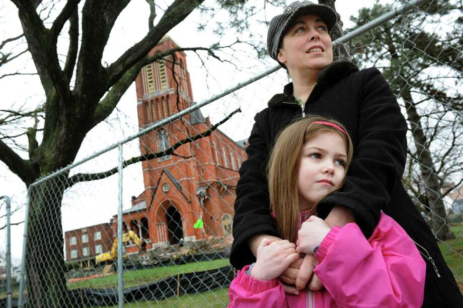 Angela Mastan of Citizens for St. Patrick's and her daughter, Olivia Miller, 6, are on site for the demolition of two side porches on Saturday, April 13, 2013, at St. Patrick's Roman Catholic Church in Watervliet, N.Y. Olivia was baptized in the church. (Cindy Schultz / Times Union) Photo: Cindy Schultz