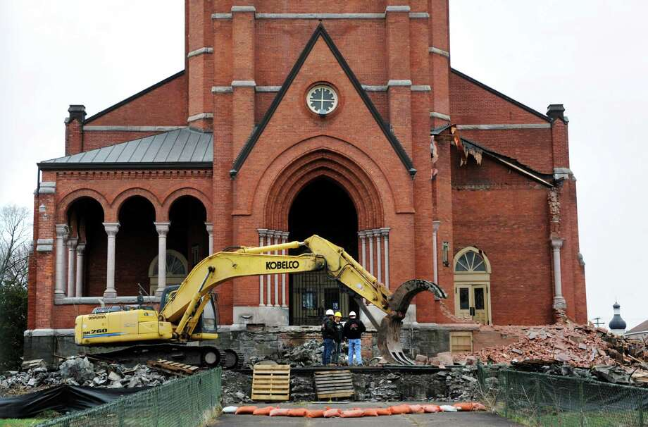 Demolition crews break after knocking down the right side porch  on Saturday, April 13, 2013, at St. Patrick's Roman Catholic Church in Watervliet, N.Y. (Cindy Schultz / Times Union) Photo: Cindy Schultz