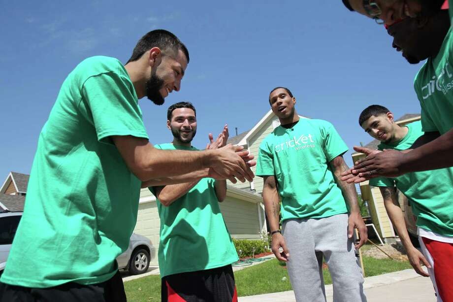 Eric Lopez, 23, and Alvaro Torres clap as Houston Rockets Greg Smith acts as their coach during the Cricket & Rockets Driveway Challenge on Saturday, April 13, 2013, in Houston. Photo: Mayra Beltran, Houston Chronicle / © 2013 Houston Chronicle
