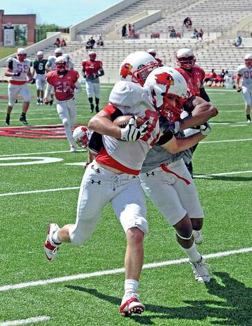 Lamar wide receiver Jesse Sparks, #81, is pushed out of bounds by Courtlin Thompson, #37, during the Lamar University football scrimmage at Provost-Umphrey Stadium on Saturday, April 13, 2013. Photo taken: Randy Edwards/The Enterprise Photo: Randy Edwards