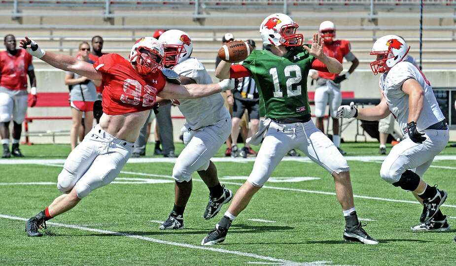 Lamar quarterback Caleb Berry, #12, looks to get the ball off during the Lamar University football s