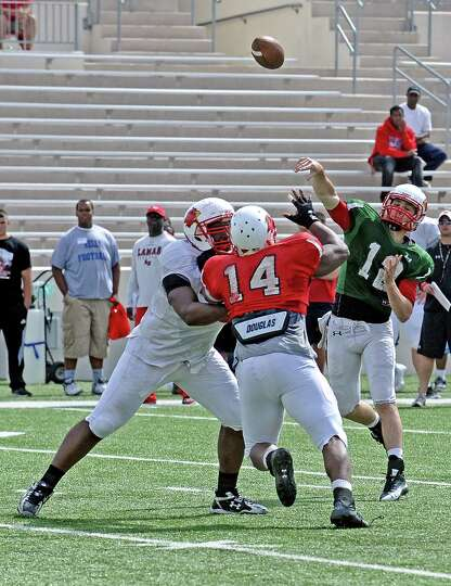 Quarterback Caleb Berry, #12, throws a pass during the Lamar University football scrimmage at Provos