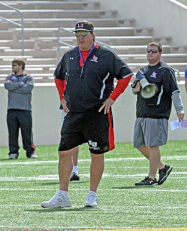 Coach Ray Woodard over looks practice during the Lamar University football scrimmage at Provost-Umphrey Stadium on Saturday, April 13, 2013. Photo taken: Randy Edwards/The Enterprise Photo: Randy Edwards